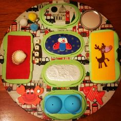 Baby sensory board using baby wipes lids. Hidden surprise under every flap e.g. buttons, shoe laces, photos, shiney beads, googly eyes