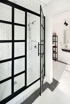 Bathroom goals. All the tile work and high contrast metalwork looks so great. Both modern and classic.