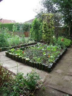 Summer vegetable patch with glass bottle edging borders by scrappy annie, via Flickr