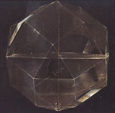 Glass rhombicuboctahedron half-filled with water from a painting of mathematician Luca Pacioli by Jacopo de Barbari, 1495; for more info see http://www.georgehart.com/virtual-polyhedra/pacioli.html
