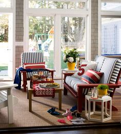 Paint the futon red and use french ticking to recover the mattress.  Our Fifth House: Making House Dreams A Reality