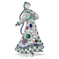 La Broche Lara a Kizhi. One of the series of figural brooch-pendants, with maidens dressed in elaborate gem-encrusted costumes, based on traditional Russian dress and embroideries. This is Lara, visiting Kizhi, the famous island on Lake Onega, celebrated for its miraculous wooden church, with twenty-two cupolas, built in 1714. Lara is made of white gold, with a rose diamond face, dressed in a costume of white diamonds, studded with emeralds, moonstones, blue sapphires, and spinels, with 373…