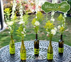 Such a cool way to use empty wine bottles...great table scape for a dinner/wine party.