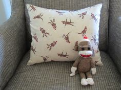 """Unique baby or child gift, includes one sock monkey pillow and one sock monkey Ty toy. Pillow measures 16""""x14"""" stuffed with pillow insert. The sock monkey cover is an envelope style so it can be easily removed and washed."""