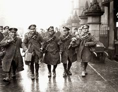 WW1: English troops return home for Christmas. For some reason, they carry their bandoleers. This was a brief respite--and then back to the trenches and most probable death.