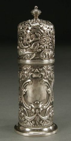 AN ENGLISH VICTORIAN SILVER MUFFINEER London 1891 makers mark W.C., Allover repousse design of birds, floral scrolls and facial masks. Height 6.75 inches Vintage Silver, Antique Silver, Facial Masks, Facial Scrubs, Art Furniture, Wood Sculpture, Silver Enamel, Lush Products, Beauty Products