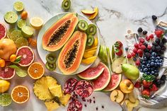 Various healthy fruits on marble table from above. Kiwi,grapefruit,papaya,apple,pear, strawberry,blueberry,raspberry,pomegranate, orange,lemon,lime and pineapple. Health & Wellness gallery by Trent Lanz for Stocksy United -Royalty-Free Stock Photos. berries, breakfast,bright,colorful,cut, daylight, delicious, diet, different, exotic, food, fresh, fruit, healthy, horizontal, indoors, kitchen, mango, meal, napkin, nobody, nutrition, organic, plate, sliced, succulent, towel…