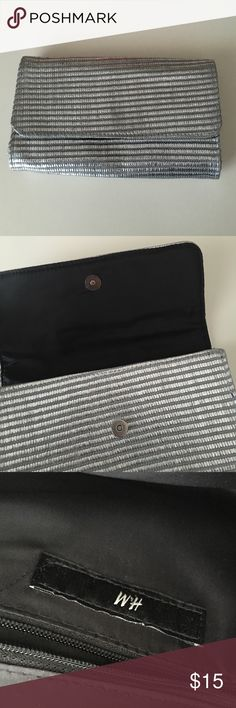 H & M large silver clutch Magnetic closure, zippered inner pocket. Used once. Large enough to hold phone, wallet, keys, makeup. H&M Bags Clutches & Wristlets