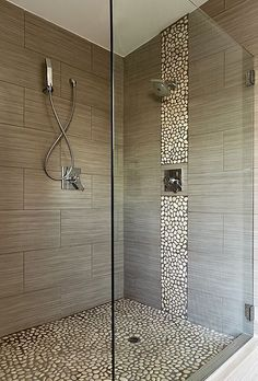 Wide SSI Walk-In frameless shower enclosure with heavy duty wall brackets, installed in a wet room luxury bathroom in London Tap the link now to see where the world's leading interior designers purchase their beautifully crafted, hand picked kitchen, bath and bar and prep faucets to outfit their unique designs. #luxurybathrooms