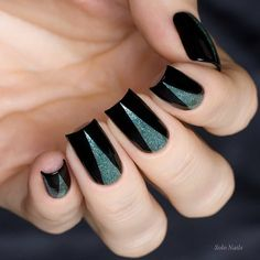 Black manicure enriched with silver pyramids on the middle of the nail is a good example how to combine black with other colors.