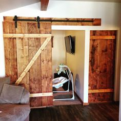 Homeowner Tips Tuesday! I thought about doing something lawn-related like grub problems but instead decided to share what I worked on yesterday. We needed new bedroom doors after renovating our small cabin and didn't want doors that swing into the room. We decided to jump on the barn door train and have one that slides inside the room and the other slides on the outside. You can use any door or buy doors like this online. I built mine for around $100 for both doors. The rail hardware can be…