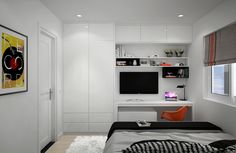 The two bedrooms in the apartment and simple but comfortable. The first carries the same color palette in from the living room with black, white, gray, and orange. The bed dominates the small space, but there is still room for a tidy study area and private television.