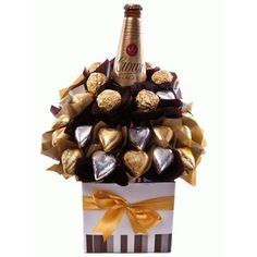 - Presented to impress, this bouquet features quality beer and creamy milk chocolate. 1 x Carlton Crown Lager 12 x Gold Milk Chocolate Hearts 6 x Ferrero Rocher Chocolates 8 x Silver Milk Chocolate Hearts Pr (valentine chocolate basket) Chocolate Flowers, Chocolate Hearts, Chocolate Bouquet, Liquor Bouquet, Candy Bouquet Diy, Send Chocolates, Ferrero Rocher Chocolates, Chocolate Hampers, Chocolate Gifts
