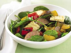 Full of leafy vegetable goodness, with juicy tomatoes, crisp spinach, hearty sausage and smooth feta, this salad is a healthy but tasty meal.