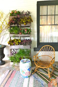 Turn a shipping pallet into a vertical garden! We love the way Grace of A Storied Style created a focal point using repurposed materials!