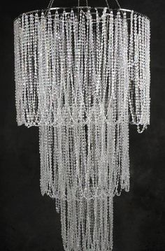 make it out of beads from the dollar store spray them silver if i ever have a girl maybe pink over a crib Crystal Garland, Crystal Chandeliers, Cheap Chandelier, Acrylic Chandelier, Plug In Chandelier, Beaded Chandelier, Chandelier Lighting, Dollar Store Crafts, Dollar Stores