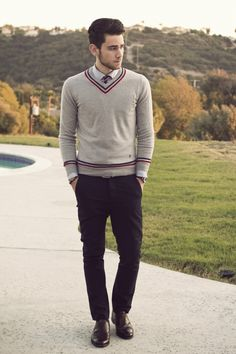 Go for a grey v-neck pullover and black chinos to create a great weekend-ready look. Black leather oxford shoes will instantly smarten up even the laziest of looks.  Shop this look for $166:  http://lookastic.com/men/looks/oxford-shoes-chinos-v-neck-sweater-tie-longsleeve-shirt/4544  — Black Leather Oxford Shoes  — Black Chinos  — Grey V-neck Sweater  — Pink Vertical Striped Tie  — Grey Long Sleeve Shirt