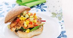 Brighten up the day with this healthy chicken burger topped with a colourful salsa.