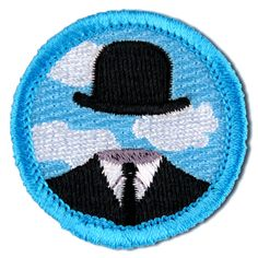 The Surrealist Merit Badge: for thinking outside the suit.