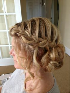 Wedding hair with a waterfall braided updo.  By Casey Powell