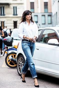 Crisp white button up, rolled up skinny jeans create a simple chic outfit.