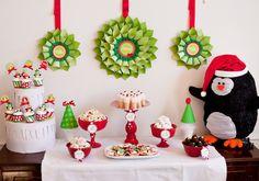 Christmas Party Table Idea - love the DIY'd paper wreaths and penguin decor!