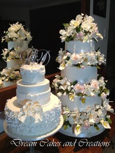 Fondant covered 4 tier with sugar flowers for that wow factor and a white on white for that more intimate celebration