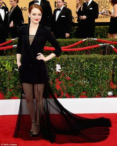 Flying solo: Emma Stone attended the 21st Annual Screen Actors Guild Awards at The Shrine ...