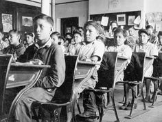 Residential school children students in a typical classroom. Thousands of Canada's aboriginal children died in residential schools that failed to keep them safe from fires, protected from abusers, and healthy from deadly disease, a commission into the saga has found (Jan. 2014)