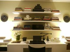 shelves with stacked books  by laura montalban
