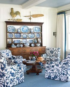 """""""Blue-and-white china inspired the choice of Lee Jofa fabric for Hickory Chair armchairs [""""Colefax""""] and a Stark rug in a sitting area by the kitchen."""" Photo: Tria Giovan. Interior design by Suzanne Kasler. Salute to Summer 