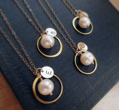 Personalized Bridesmaid gifts, Set of 4: FOUR Gold Eternity Necklaces, Pearl & Initial necklaces, jewelry gift sets, karma necklaces. $116.00, via Etsy.
