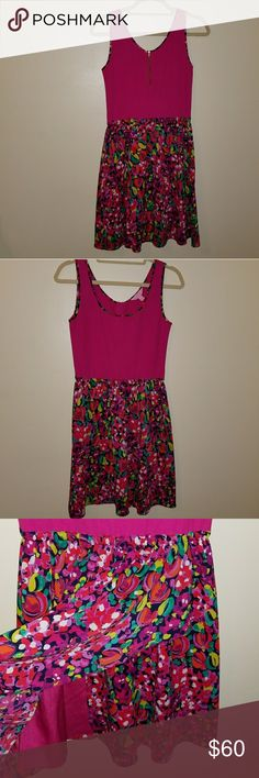 Lilly Pulitzer dress Pink floral dress, stops above knee. Bottem half of dress has wrap feature Lilly Pulitzer Dresses