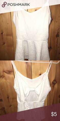 a3b12054ed24b Peplum style top - bow back An all white spaghetti strap peplum top with a  bow