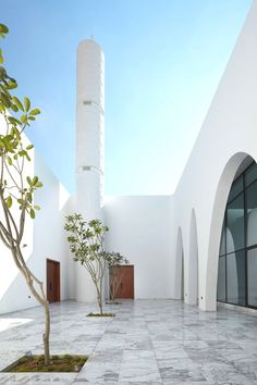 Arched openings in the sandstone facade of this Dubai mosque by Ibda Design lead worshippers into a bright marble courtyard with a textured minaret Facade Design, Patio Design, Exterior Design, Minimalist Architecture, Contemporary Architecture, Architecture Design, Mosque Architecture, Religious Architecture, Architecture Concept Diagram