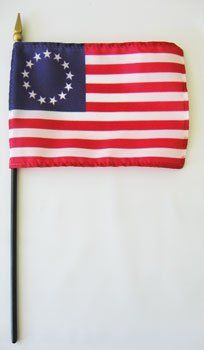 """Betsy Ross - 4"""" x 6"""" Historic Stick Flag by Flagline. $3.00. 4'' x 6'' stick flag. Mounted on 10 inch staff with gilded spear point. The Betsy Ross flag is an early design of the flag of the United States popularly attributed to Betsy Ross using the common motifs of alternating red-and-white striped field with white stars in a blue canton. The flag was designed during the American Revolution and features 13 stars to represent the original 13 colonies. The distinctive featu..."""