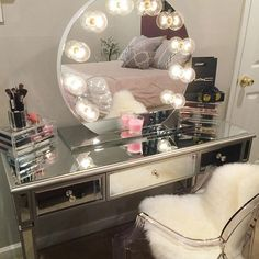 """If rectangle mirrors are just too """"square"""" for you, find a round mirror like dulcetrocaf did. It still provides you with plenty of area for getting ready, but it adds an element of glamour you don't get from a standard design."""