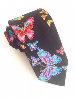 Colourful Butterfly Tie #VanBuck #Butterfly #Tie #NeckTie #Butterflies #Dapper #Accessories #MensFashion #MensAccessories  http://www.fabties.com/ties/novelty-ties/colourful-butterfly-tie.html