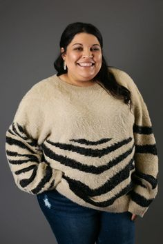 Cozyand Cute! The Zebra printed sweater in Khaki has oversized sleeves, a fuzzy but not scratchy fabric, and a round neckline. You can pair this versatile sweater with denim and sneakers or leather leggings and booties! Jodeci 5'1 and wearing the size large. True to size with relaxed fit. WE ONLY ACCEPT RETURNS FOR Trendy Tops For Women, Leather Leggings, Zebras, Zebra Print, Casual Wear, Going Out, Men Sweater, Neckline, Cozy