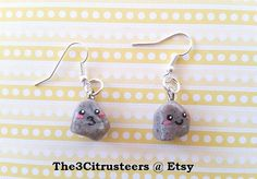 One pair of Handmade Pet Rock Dangle Earrings, Made From Polymer Clay is up for grab! This is perfect for any pet lovers! It is a chance to take