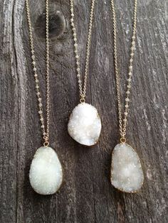 White druzy necklaces are accented with wire wrapped moonstone chain for a cool, bohemian vibe. Stone pendant hangs from Gold plated chain and