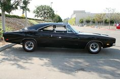 '69 Dodge Charger R/T  --My hubby had one just like this when he was 17!  His had a 440 big block with 4 on the floor!  Wish he still had it, waaa!!!