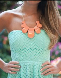Mint and coral.---cute chevron dress, and a knock-off statement necklace that looks the part but doesn't kill your wallet. Be sure to look at any Charming Charlie, Charlotte Russe, Francesca's (a little bit pricier), or other stores like them.