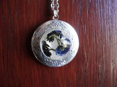 Locket necklace with forget-me-not flowers in resin by zusnA
