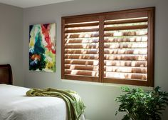 """These 4 1/2"""" Teak Wood Shutters are a great option for bedrooms. Offering large slats means you have better control over the light in the room. #shutters #teakwoodshutters #smithandnoble #smithandnobleshutters #bedroomwindows"""