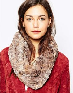 98afb9eed18 Pia Rossini Faux Fur Snood In Animal Print at asos.com