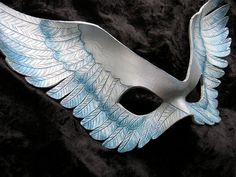 """Winged leather mask- """"Valkyrie"""" in white, frost blue, and silver. $120.00, via Etsy."""