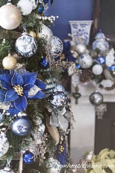 Blue and white Christmas decorations are my favorite! I love the idea of using ginger jars as part of the fireplace mantle decor. Blue Christmas Tree Decorations, Types Of Christmas Trees, Gold Christmas Tree, Beautiful Christmas Trees, Christmas Mantles, Christmas Villages, Victorian Christmas, Christmas Ornaments, Christmas Christmas