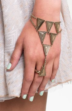 """This interesting take on a bracelet is taking your average jewelry to a whole new level. This """"hand ornament"""" is a mixture between a bracelet and a ring that connect on the outside of the hand. This look is unique and different, and adds a lot of edge to an outfit without being over the top. Lauren B."""