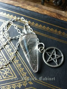Rutilated Quartz Pendulum with Pentacle Fob, Divination Tool, Pendulum, Energy Work, Spiritual Tool, Enlightenment, Pagan, Pendulum #1 by TheMagickCabinet on Etsy